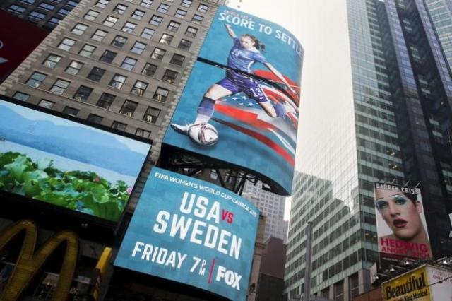 A digital billboard advertising the Women's World Cup is seen at Times Square in New York, United States, June 11, 2015. REUTERS/Shannon Stapleton